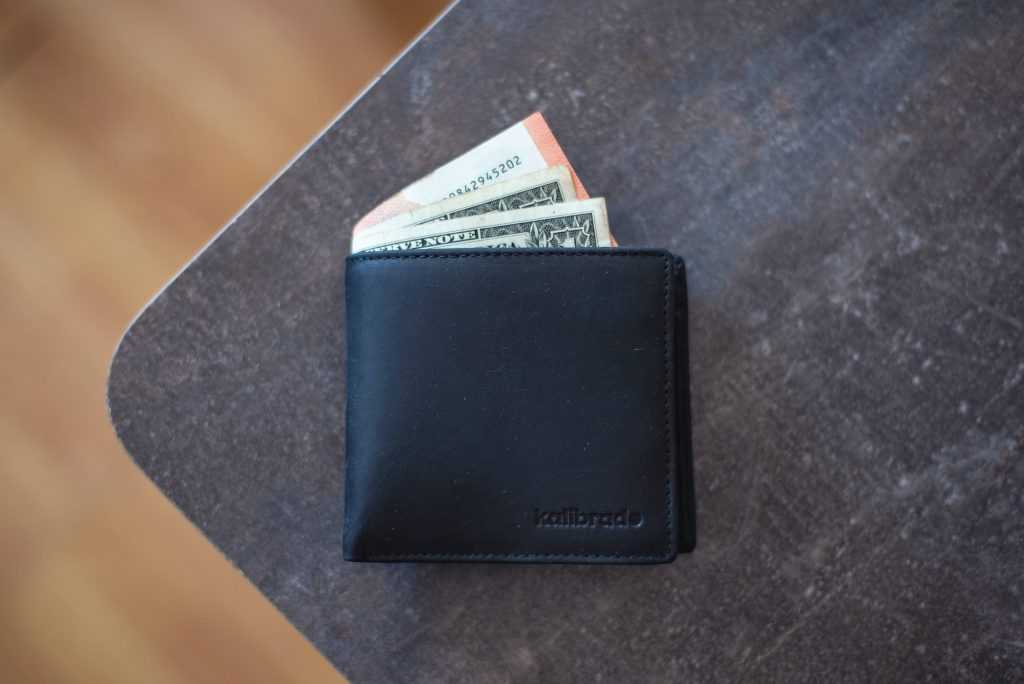 Wallet with cash sticking out