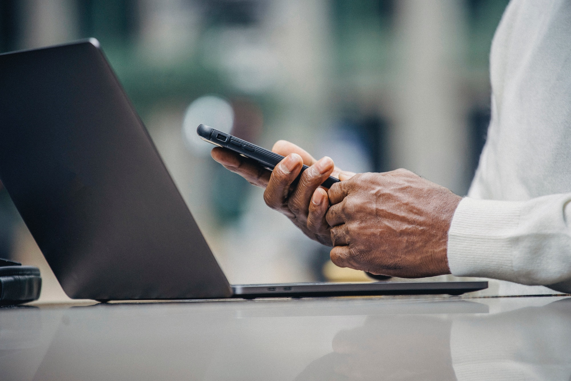 Man on phone and computer investing